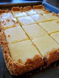 CREAMY LEMON SQUARES: FOR THE CRUST 4 tablespoons butter, melted and cooled, plus more for pan cup graham cracker crumbs ¼ cup sugar FOR THE FILLING 2 large egg yolks 1 can ounces) sweetened condensed milk ½ cup fresh lemon juice lemons) How 13 Desserts, Lemon Desserts, Lemon Recipes, Sweet Recipes, Recipes For Lemons, Lemon Cakes, Party Desserts, Low Carb Dessert, Dessert Bars