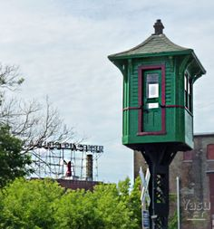 Old Railroad tower and Utica Club Brewery sign in background