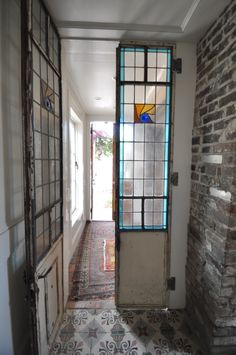 The doors and windows at Race & Religious are all different. These stained-glass beauties lead into the downstairs powder room.