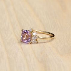 CERISE PINK Engagement Rng by Grew & Co. Features a cushion cut Pink Sapphire framed by mixed cut diamonds to create a spray design. Crafted in 18 carat Yellow Gold on a Grew & Co signature band. Cerise Pink, Cushion Cut, Pink Sapphire, Precious Metals, Diamond Cuts, Centre, Diamonds, Rose Gold