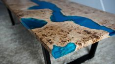 Handmade river resin coffee table. Blue semi-translucent transparent epoxy. Mappa Burl. Legs made of metal coated with black colour. Its unique, one of a kind solid piece of wood. The unique combination of tree rings to bring out the effect of the variety of colors. Dimensions: 159 x