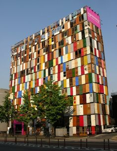 A building covered in old doors.  This website has a lot more photos of art by Choi Jeong-Hwa. I really like his use of materials!!