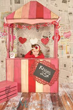 This unique adorable newspaper background Valentine kissing booth was photographed by http://www.facebook.com/#!/pages/Melanies-Photo-Shoppe-Photography/349986673226?fref=ts