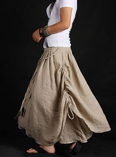 The skirt was designed by a buyer.  It has double layers, adjustable strap on the waist, ended with 4 pieces of peacock feather. Outer