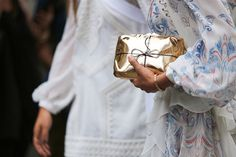 gold-satchel-tied-with-a-string purse