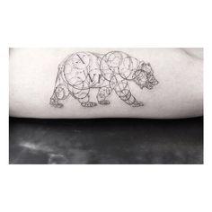 A sort of geometric bear tattoo?