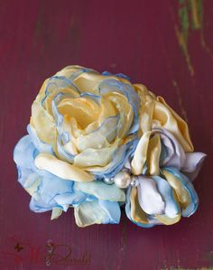 Blue buttercup satin flower handmade fancy hair by faeryfloral, $15.00