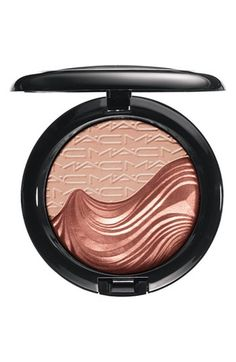 M·A·C Extra Dimension Skinfinish ($30 @  nordstrom.com). A liquid-powder highlighter with prismatic reflections that sculpts, highlights and models the face. The cool, creamy, near-fluid formula creates a luminous, well-defined finish. Lasts 10 hours.