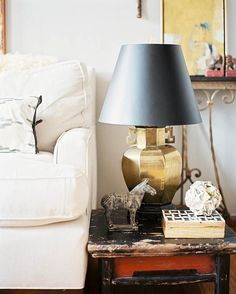 brass lamp with black shade
