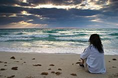 Sitting on the sand, watching the tide.  I've done this a hundred times ... anyone else?
