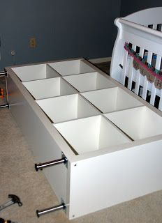ikea expedit shelve hack---want to add legs like this to the piece that I have similar to this