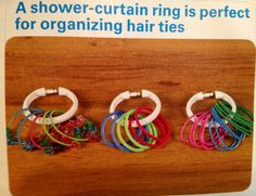 A shower curtain ring is perfect for organizing hair ties...