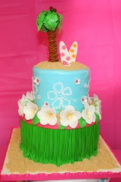 """Hawaiian Luau Cake - Got a request for a Hawaiian Luau cake with leis and surfboards. Cake is 8"""" and 6"""". Decorations are all fondant, gumpaste, and royal icing. Have been wanting to try brushed embroidery, looks okay for a first try. Thanks for looking!"""