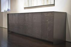 Graphite Eelskin And Oxidized Steel Dining Credenza by Michael Wong: when only the finest dyed eelskin credenza will do.