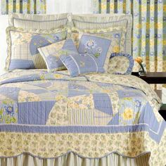 i would LOVE to learn how to quilt something like this. butter yellow and baby blue. so pretty.