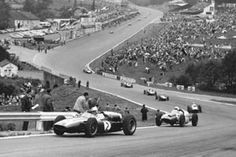Cars stream through Eau Rouge during the Belgian Grand Prix at Spa-Francorchamps. © Allianz