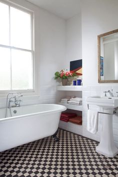 House in Brixton in the UK by A Small Studio - Design Milk The floor and roll top bath. Bad Inspiration, Bathroom Inspiration, Black And White Bathroom Floor, Roll Top Bath, Victorian Bathroom, Bathroom Floor Tiles, Tile Floor, Shower Floor, Wall Tiles