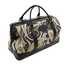 This amazing weekend bag in black paisley canvas and leather is handmade in England.