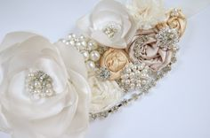 Beaded rhinestone and pearl ivory satin and lace sash. $45.00, via Etsy.