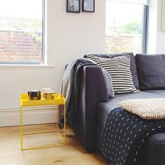 We think the £39 Mondrian tray table adds a dose of colour to this simply stylish room. (Also pretty handy when carrying tea and biscuits from the kitchen).