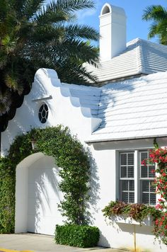 Designed by Architect Howard Worth, this little group of attached residences were inspired by Bermuda architecture. Boxwood covering base of vine Small Garage Door, Garage Doors, Exterior Design, Interior And Exterior, Modern Exterior, Patina Style, Halls, Outdoor Living, Outdoor Decor