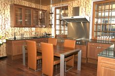 Wooden kitchen with eat-in area, hard wood floor and vibrant wall design