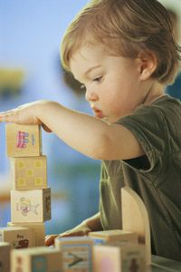 Toys like building blocks can help boost fine motor skills and small muscle development.