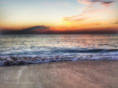 surf on the beach at sunrise (Delaware) by delmarvausa