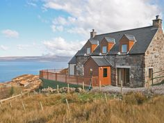 This superbly presented detached stone cottage is perched on the edge of the sea in a rural and coastal location.