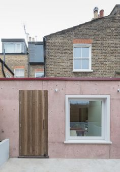 Pink concrete extension adds warmth and texture to brick house in London - Curbedclockmenumore-arrow : Who knew that pink concrete could be so calming? Murs Roses, Detail Architecture, House Extensions, North London, Dusty Pink, Cement Walls, Concrete Wall, Brick Walls, Brick Facade