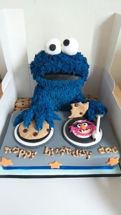 Cookie Monster cake complete with fondant cookies. By Sarahs Cakes by Design.
