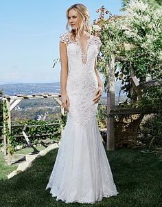 Wedding Dresses by Lillian West | Wedding Dress & Bridal Gown Designer | All Styles deep V neck cap sleeves beaded lace fit and flare. Find Lillian West at a bridal boutique located in dfw area.