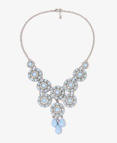 I personally own this necklace. It looks great with a berry pink or light grey !!
