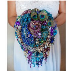Peacock bouquet, Brooch bouquet, Peacock Wedding, Bridal Bouquet, Jewelry Bouquet, Blue Purple Bouquet, Wedding Bouquet, Turquoise Bouquet by TatyanaAgulina on Etsy https://www.etsy.com/listing/117924570/peacock-bouquet-brooch-bouquet-peacock