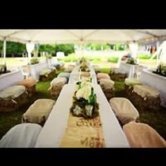 Reception Tent with Hay Bale Seating (Change Flowers, No Table Runners, & Change to Orangey Peach Blankets on the Hay Bales)
