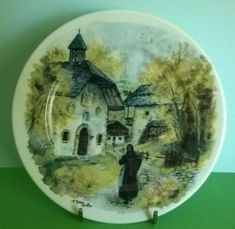 """A very attractive decorative plate of a village church and a woman carrying wood. Terra Vecettia"""" near the rim. Shrewsbury Shropshire, Catholic Religion, Woman Illustration, Prayer Cards, Trinket Boxes, French Vintage, Decorative Plates, Porcelain, Ceramics"""