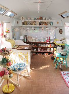 Love the look of this old camper turned into a traveling shop!