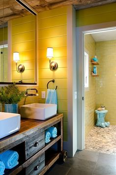 From the front door to the bathroom, the combination of modern, updated convenience and rustic touches is pitch perfect. Check out that shower area!