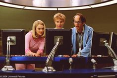 Thunderbirds - (L to r) Lady Penelope (SOPHIA MYLES), Alan Tracy (BRADY CORBET) and Brains (ANTHONY EDWARDS) behind the control center of International Rescue in the family action-adventure, Thunderbirds