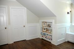 wainscoting to tie in the built-in bookshelves already present