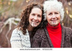 FOR: PF family - mother/daughter A portrait of a happy senior woman with her adult daughter - stock photo