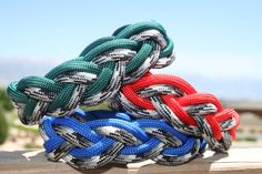 Paracord Bracelets Blue, Red, Green, and Black White and Grey Camo. $11.00, via Etsy.