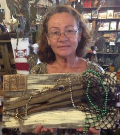 """This folk art, """"Swamp Babette,"""" is handmade from found Mardi Gras beads, fishing net, & wood. Come check out our fascinating collection of folk art for sale!"""