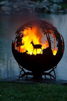 (Up North Custom Outdoor Fire Pit - Hand Cut Steel Sphere). This is definitely going in my new teeny-tiny cabin's yard. Fire Pit Globe, Fire Pit Sphere, Metal Fire Pit, Fire Pits, Fire Pit Gallery, Custom Fire Pit, Deco Nature, Fire Pit Designs, Fire Bowls