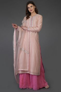 From our Indian Spring Collection, this Pressed Rose chanderi kurta is adorned with beautiful resham and silver tilla embroidery. Paired with crushed kota silk sequin sprinkled sharara and organza silk dupatta. The chanderi kurta is embroider Indian Dresses, Indian Outfits, Embroidery Suits Punjabi, Zardozi Embroidery, Sharara Suit, Salwar Dress, Salwar Suits, Indian Designer Suits, Kurta Designs