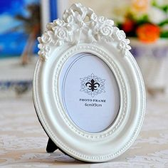 Giftgarden® White Oval Picture Frame 2.3x3.5 Inch Giftgarden http://www.amazon.com/dp/B010N3UOLS/ref=cm_sw_r_pi_dp_kguuxb0H9PA9D