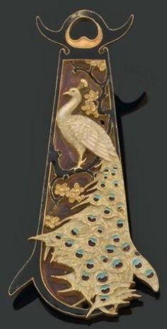 Lalique 1893-96 Oblong Peacock Pendant: 18k gold decorated w/ cloisonné enamel: white/ peacock-blue/turquoise/purple. A branch of fruit tree & flowers carved w/black enamel. Pierre Bergé & Associés
