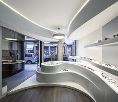 Novaóptica - optical store by Tsouarquitectos as Architect