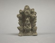 Figure Seated in Grotto.