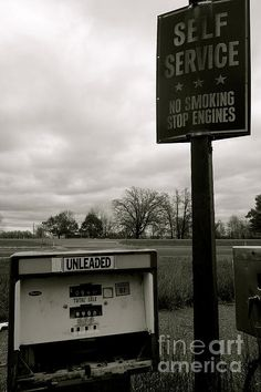 No Smoking Stop Engines www.jacquelineathmann.com  Gas Pump, gas station, station, Gasoline, Pumps, lighting, self service, engines, car, automobile, decay, aged, old, antique, vintage, grass, pavement, concrete, sepia, cloudy, sky, tree, trees, road, old school, old skool, manual, auto, lamp post, post, lamp, garrison, Minnesota, abandoned, rural, urban, city, country, fall, aged, forgotten, rot, rotten, broken, broken glass, nature, landscape, street, street lamp, branches, hose, hoses…